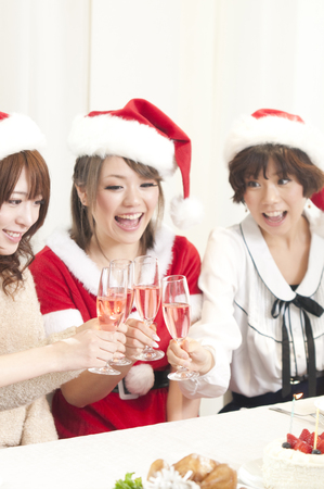 rollick: Three women to toast with champagne Stock Photo