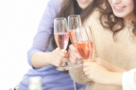 Hand of four women to toast with champagne
