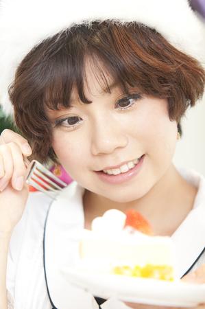 resound: Woman eating cake Stock Photo