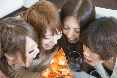 resound: 4 women surrounding the pizza