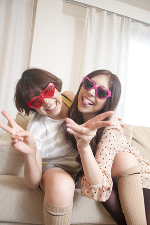 resound: Two women frolic it with sunglasses