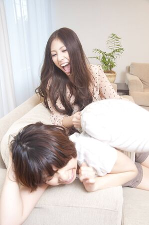 pillow fight: 2 women for a pillow fight