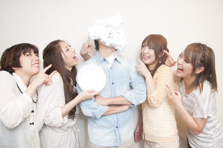 rollick: 4 women surrounding the pie throwing have been male Stock Photo