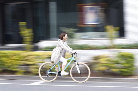 Women ride bicycles