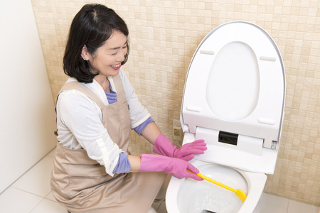 Senior woman to the toilet cleaning