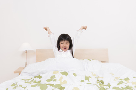 family with one child: Girl get up from bed
