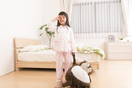 rubbing: Girl to wake up while rubbing sleepy eyes