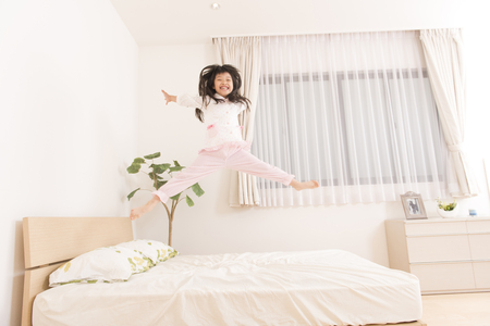 Girl to jump on the bed