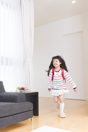 Girls running shoulder school bags photo