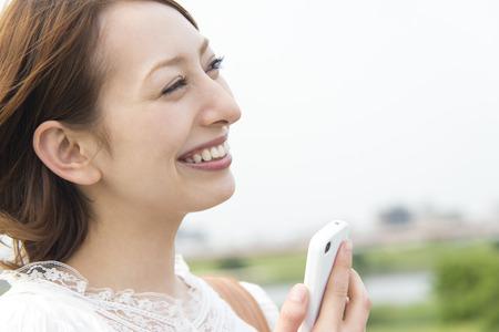 exert: Women touch Smartphone