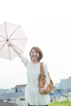 parasol: Using a parasol smiling woman