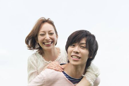 Woman hugging man from behind photo