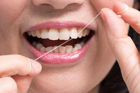 dental floss: Senior women using dental floss Stock Photo