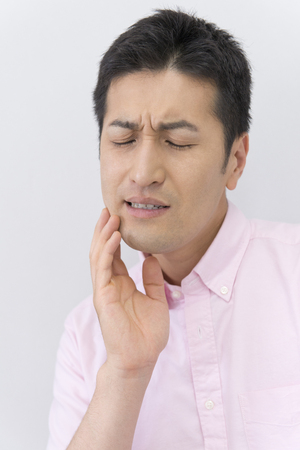 complain: Men complain of tooth pain Stock Photo