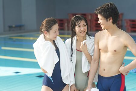 bath towel man: Men and women chatting after swimming