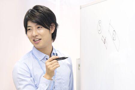 explained: Businessman to be explained using the whiteboard Stock Photo