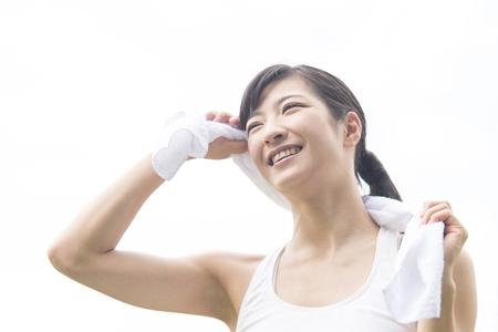 wiping: Woman wiping sweat