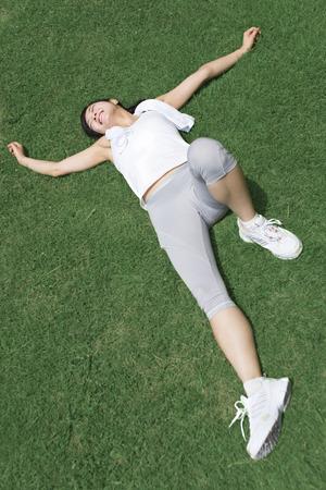 Women lie on the lawn