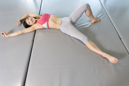 lie: Women lie down in the mat