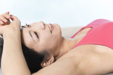 lie down: Women lie down in the mat