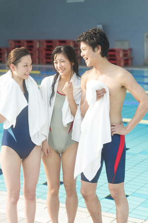 Men and women chatting after swimming