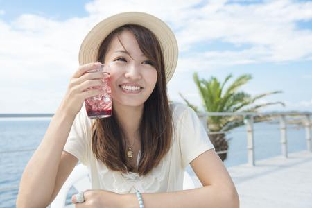 Women drink Cassis soda photo