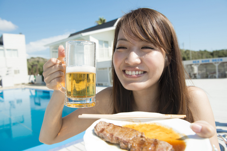 asian foods: Women with beer and grilled meat