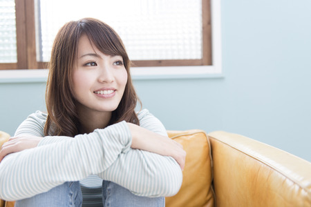 loosen up: Women smile sitting on the sofa