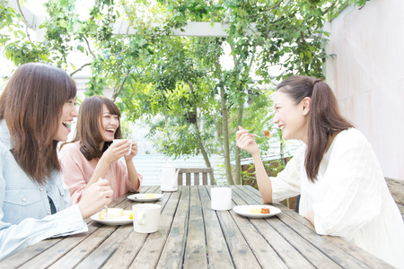 Three women chatting in the Cafe