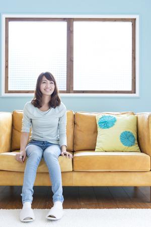 loosen up: Women on the sofa Stock Photo