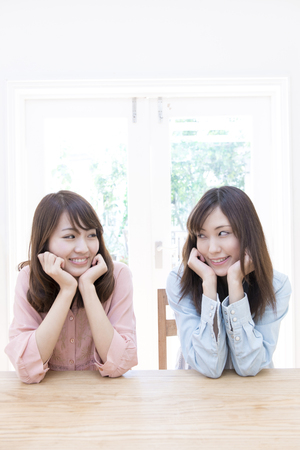 eagerly: 2 women smiling and with a Hozue