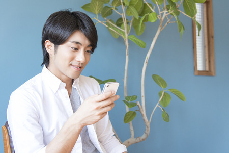 Men touch Smartphone Stock Photo