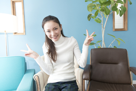 far away look: The V sign woman Stock Photo