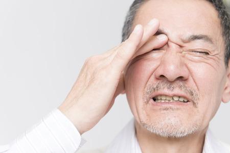 complain: Senior men complain of eye pain Stock Photo