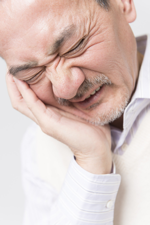 agonizing: Senior men complain of tooth pain Stock Photo