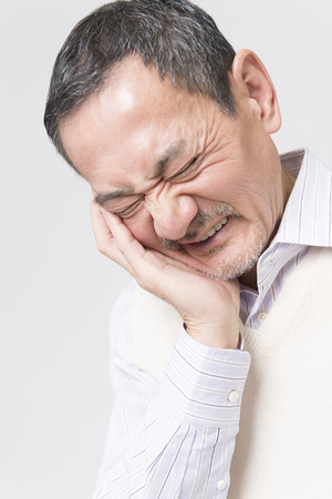 tooth pain: Senior men complain of tooth pain Stock Photo