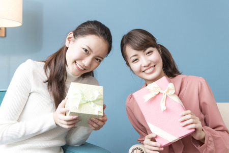 2 women with a gift Stock Photo