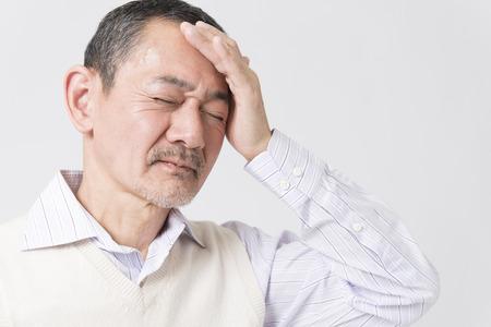 シニア頭痛を訴える男性 写真素材