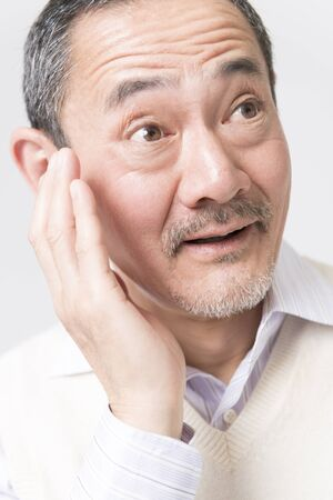 eliminated: Senior men of tooth pain is eliminated Stock Photo