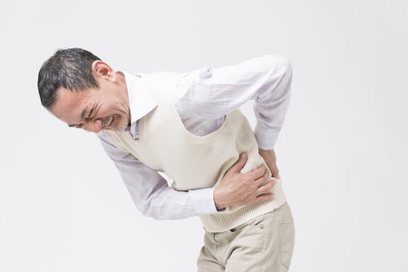 complain: Senior men complain of low back pain Stock Photo