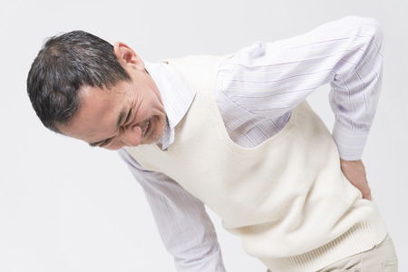 low back: Senior men complain of low back pain Stock Photo