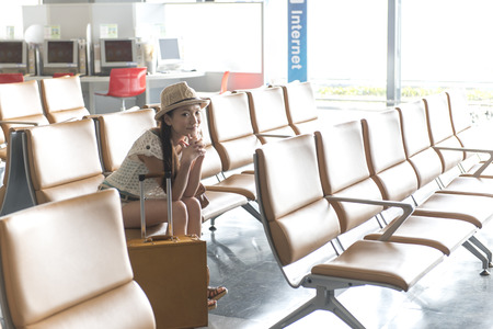 Women who sit in airport lounge