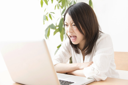 occurs: Women that occurs by looking at the laptop