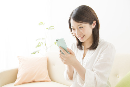 Women have a smart phone and smile Stock Photo