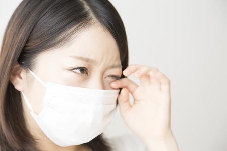 to rub: Women rub their eyes Stock Photo