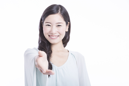 手を差し伸べる女性 写真素材