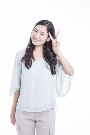 The V sign woman Stock Photo