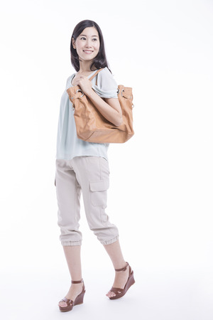 Woman smiling with a bag
