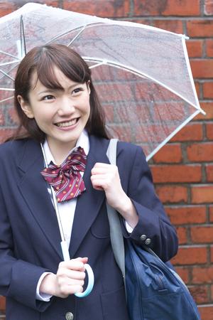put up: High school girls put up an umbrella