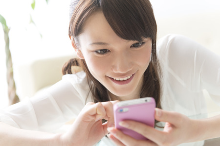 multi family house: Women working with smart phones Stock Photo